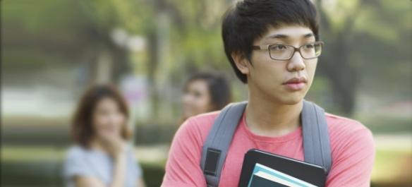 Sad Asian teenage boy